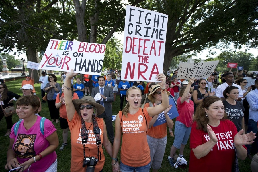 Protesters call for House Speaker Paul Ryan to allow votes on gun violence prevention legislation in Washington, D.C., on July 6, 2016. (Photo: Manuel Balce Ceneta/AP)