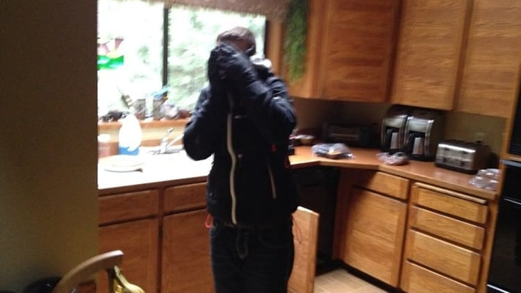 The homeowner snapped a picture of alleged burglar, Zachery Summers, 29, who covered his face in front of the camera. (Photo: Washington County Sheriff)