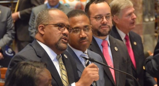 Sponsored by state Sen. Troy Carter, seen at the mic, SB 274 would put a broad class of guns off-limits to a segment of adults under age 21. (Photo: Sen. Carter, Facebook)