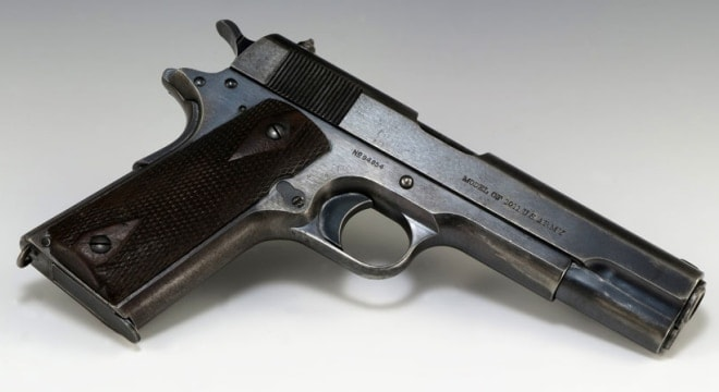 U.S. martial M1911s were in production from 1912-1945 from companies as diverse as Ithaca, Remington-UMC, Singer, and US&S. (Photo: National Archives)
