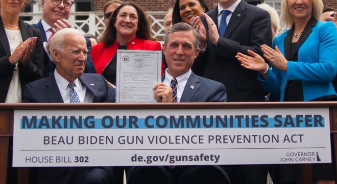 Gov. John Carney joined fellow Democrat, Vice President Joe Biden, at the Biden Institute at the University of Delaware this week to sign a gun control bill into law named in honor of Biden's late son, the state's former attorney general. (Photo: Carney's office)
