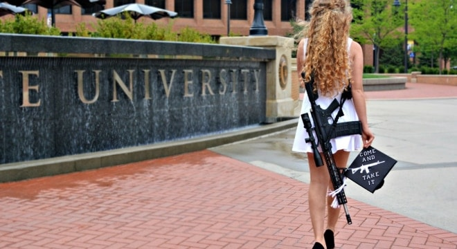 Kent State graduate's campus carry photos goes viral, spark controversy (VIDEO)