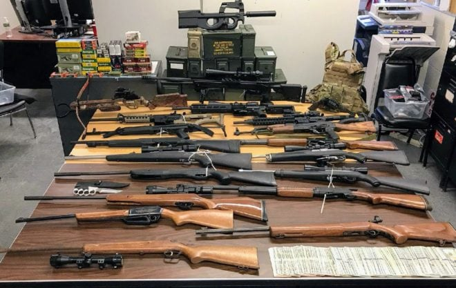 """Keith Harvey, 44, was charged with dozens of weapons violations over what the Queens DA characterized as a """"warehouse of lethal shhotguns and rifles."""" (Photo: 105th Prescient)"""