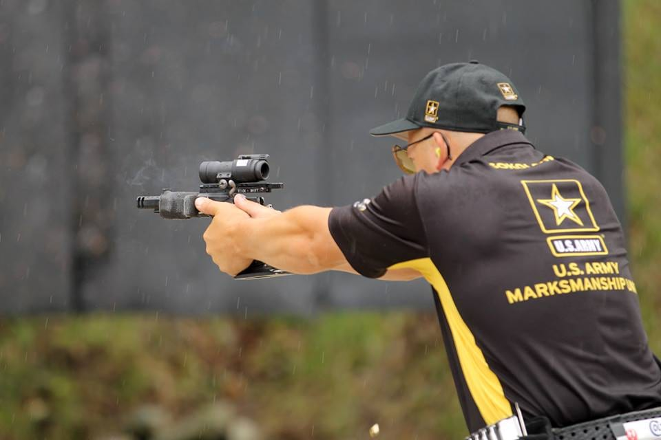 Sgt. 1st Class Adam Sokolowski fires off his last event, the Falling Plates, in the rain to win his historic Bianchi Cup Champion title (Photo: U.S. Army)