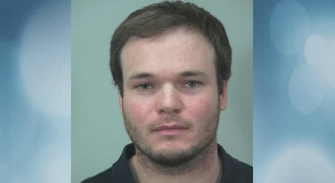 Fahy told police he was in the wrong bathroom accidentally, but security footage showed that he had been there for 14 minutes. (Photo: Dane County Jail via Channel 3000)