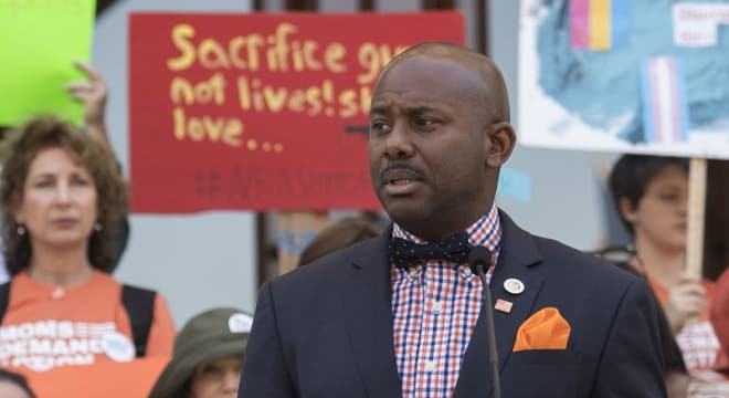 Assemblymember Mike Gipson, seen here at a gun control rally, says regulating gun parts currently sold online and over the counter is needed for public safety. (Photo: Gipson's office)