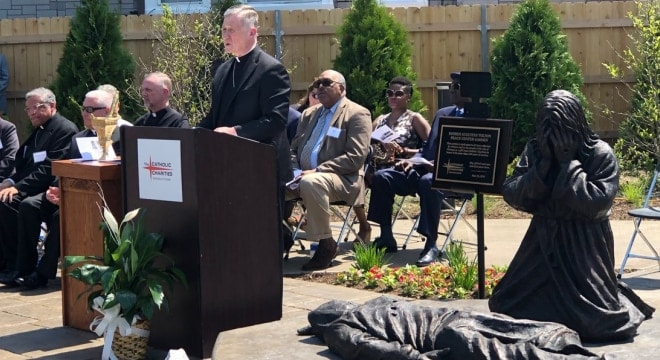 Cardinal Cupich dedicated the Tolton Peace Center in Chicago's Austin area last month, which includes a sculpture by artist Timothy Schmalz entitled Thou Shall Not Kill depicting Jesus weeping over a gunshot victim. (Photo: The Chicago Catholic) https://twitter.com/chicagocatholic/status/999731567017807872