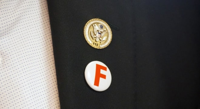 Both sides of the gun rights debate often tout their grades from the NRA, such as the above shown on the lapel of U.S. Rep. John Yarmuth, a Democrat from Kentucky who has backed a number of gun control proposals. (Photo: Rep. Yarmuth)