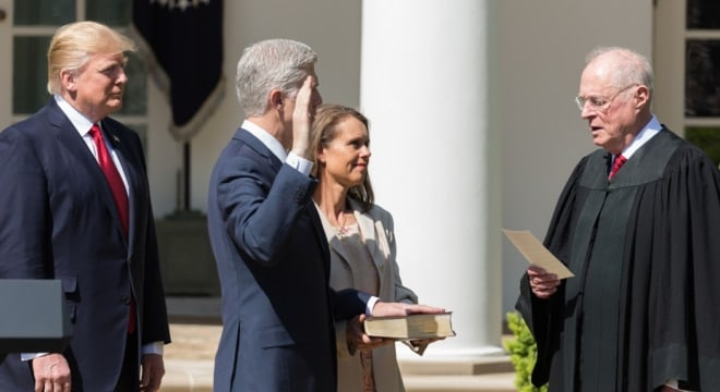 Anthony M. Kennedy, Associate Justice of the Supreme Court of the United States, swears in Supreme Court Justice Neil M. Gorsuch on Monday, April 10, 2017, in the Rose Garden of the White House in Washington, D.C. (Photo: Shealah Craighead/Official White House photo)