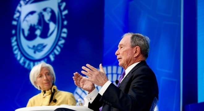 Michael Bloomberg speaking at the International Monetary Fund Spring Meetings in April with IMF Managing Director, Christine Lagarde. (Photo: mikebloomberg.com)