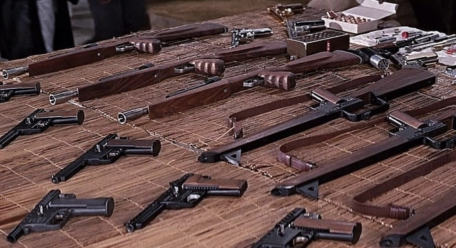 The Gyrojet pistols and rifles on Tanaka's table from the film. These guns-- and their rocket ammo-- would be worth a small fortune today to the right collectors. (Photo: IMFDB)