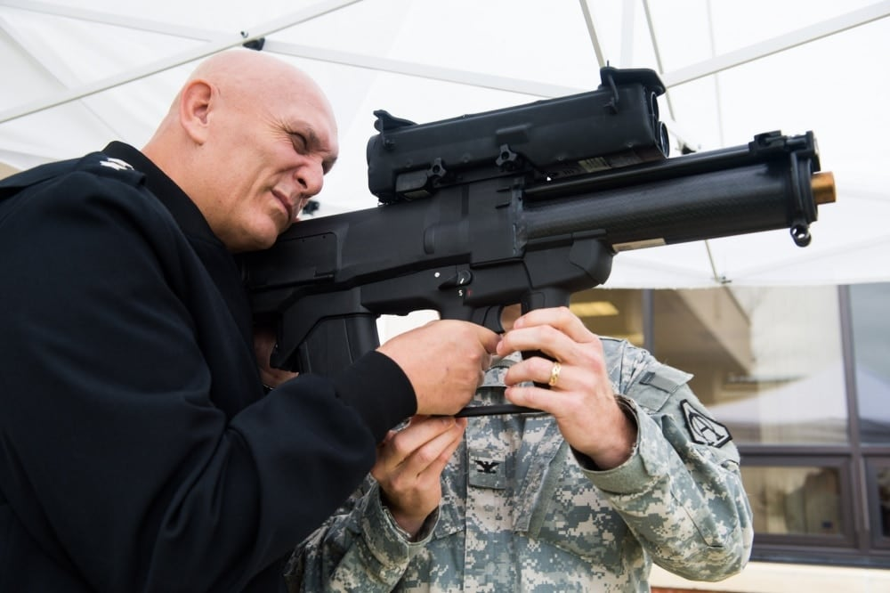 Then-U.S. Army Chief of Staff Gen. Ray Odierno looks through the sight of an XM25 during his visit to Fort Belvoir, Va., Nov 1, 2013. Canceled by the Army last April, it was announced the program was officially ended last week. (Photo: DoD)