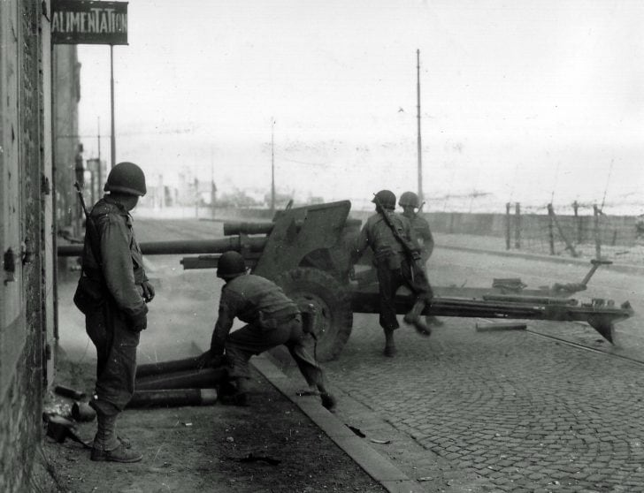 Gunners from the 802nd Tank Destroyer battalion firing an M5 antitank gun in Saint-Malo againt German trops, 1944.