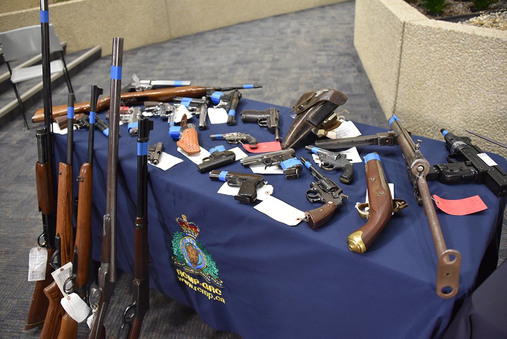This display shown off by the Mounties looks like it may have belonged in better days to a WWII-era weapon collector and the person that inherited it didn't know what they had. What looks like a pair of distinctive Czech CZ 24/27 pistols are in the center of the photo just below a German P-38 with its companion holster. An M1 Carbine is to the far left while what seems to be a STEN and UZI to the right, the latter both likely dewatted as the RCMP didn't make a big deal of it in their announcement. Also, drink in the flintlock black powder pistol and the Damascus steel SXS which likely dates to the days before the 1900s.