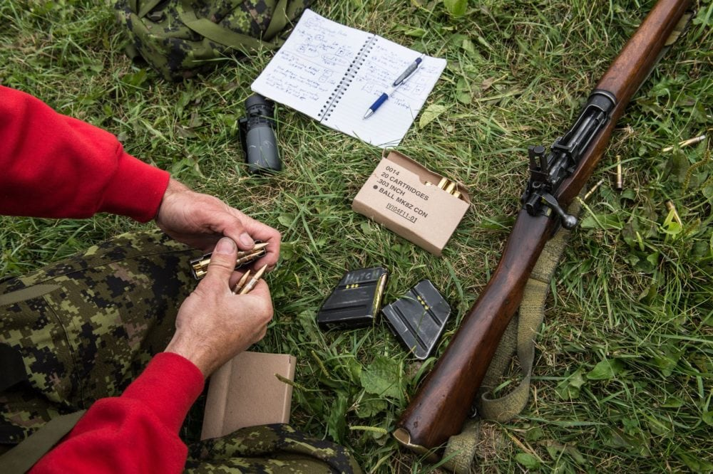 Enfield 4 Canadian Ranger Patrol Group (4 CRPG) reloads his magazines during a range practice at the Canadian Armed Forces Small Arms Concentration
