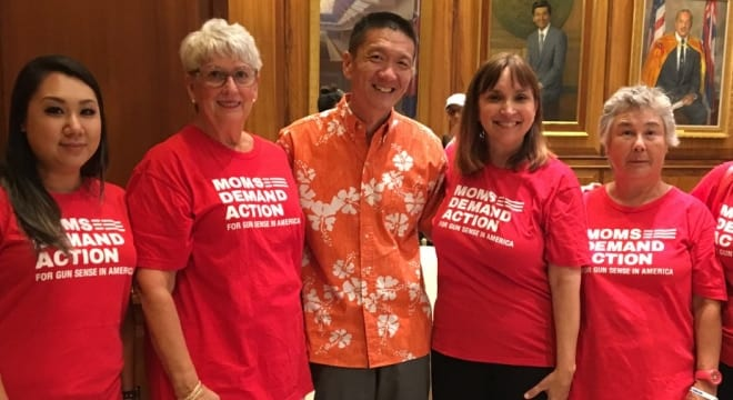 "Hawaii Lt. Gov. Douglas Chin, seen at the signing of a gun control bill with Moms Demand Action advocates in July, said ""To promote public safety, we must defend our state laws,"" in response to a challenge to the state's restrictive laws on open carry. (Photo: Chin's office)"