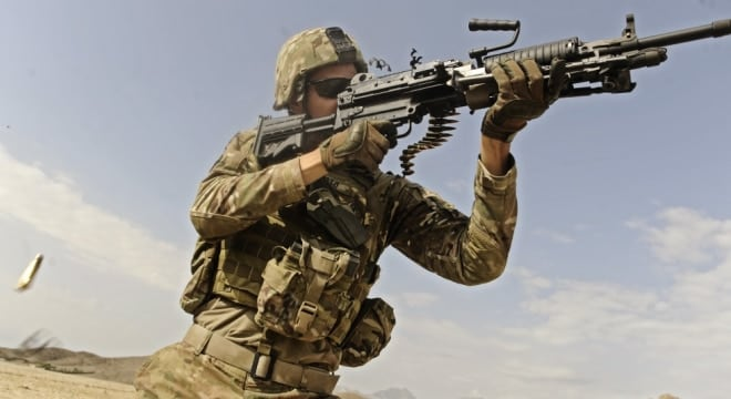 "A Solder fires a fires the Mk48 ""super SAW"" machine gun. (Photo: DoD)"