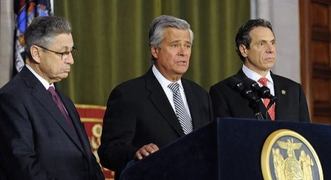 Dean Skelos, center, seen in this file photo with then-New York Assembly Speaker Sheldon Silver to his left and Gov. Andrew Cuomo, steered the SAFE Act through the state Senate in 2015. (Photo: NY Governor's Office)
