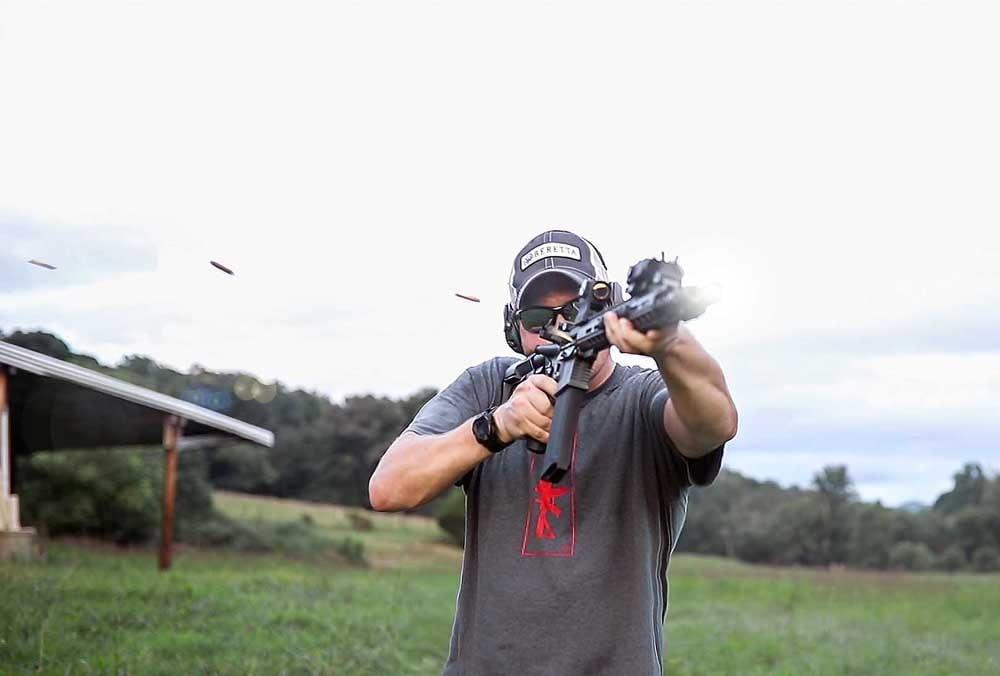 male shooting the mod mat ace ar15 gun outdoors