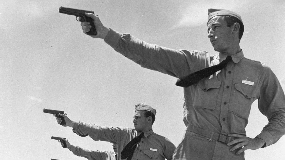 U.S. martial M1911s were in production until 1945 from companies as diverse as Remington-UMC, Singer, and US&S and some are filtering through the CMP. (Photo: National Archives)