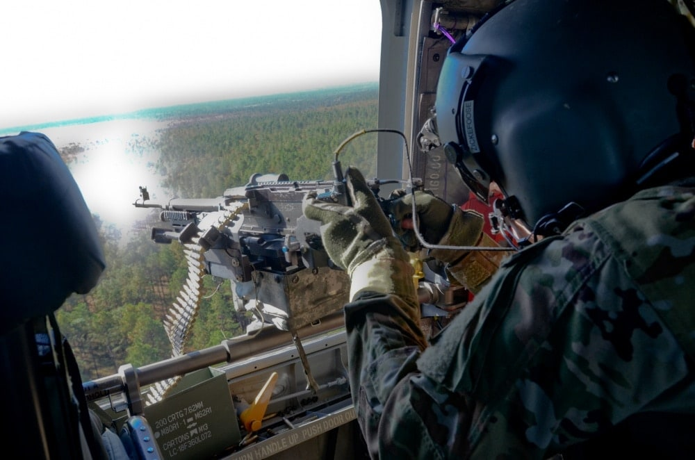 CH-47 helicopter 3rd General Support Aviation Battalion, 82nd Aviation Regiment, 82nd Airborne Division Combat Aviation Brigade, fires an M240H machine gun from a CH-47 Chinook during a Combined Arms Live