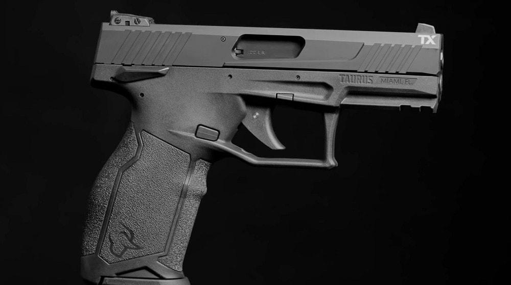 taurus tx22 rimfire pistol on black background