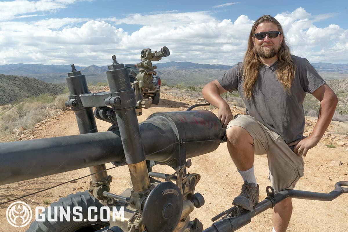 Bob Bigando standing next to 105mm rifle Icarus