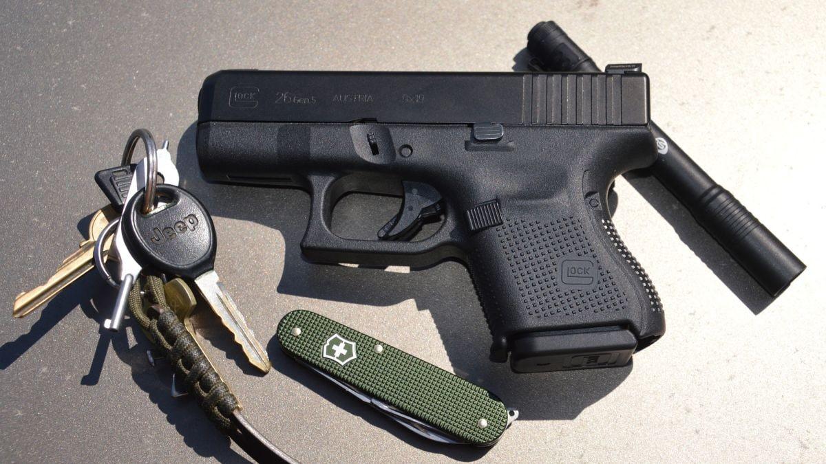 Glock, keys, knife, flashlight