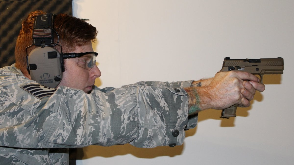 Air Force Security Forces Airman with M18 Sig pistol