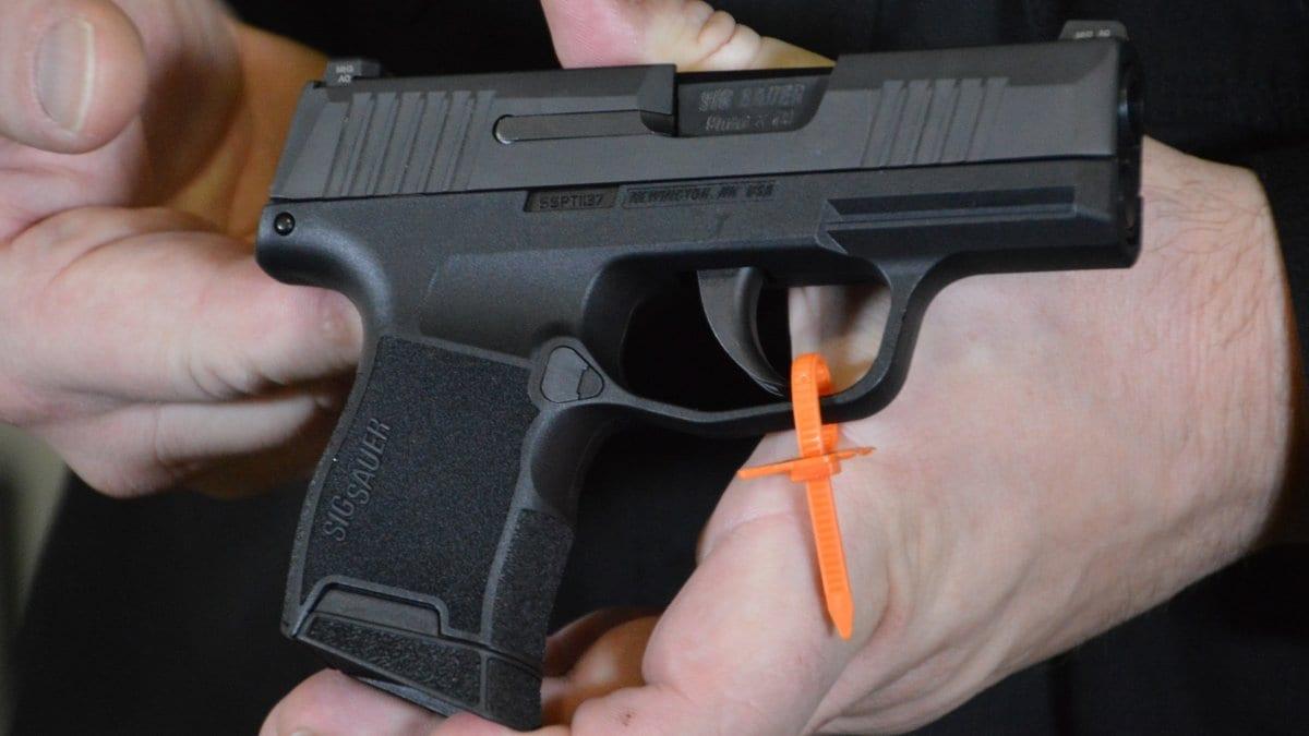 sig P365 pistol in man's hands