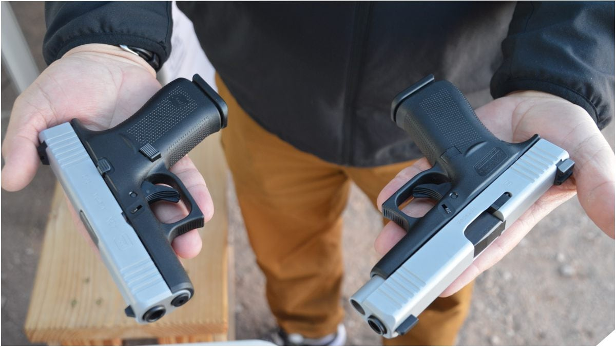 Glock 43X and Glock 48 handguns held in a man's palms