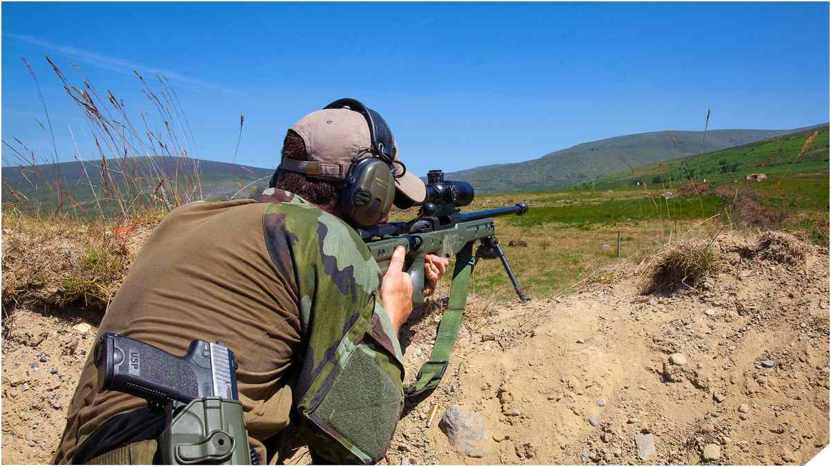 Irish Army sniper with Accuracy International rifle and HK USP pistol