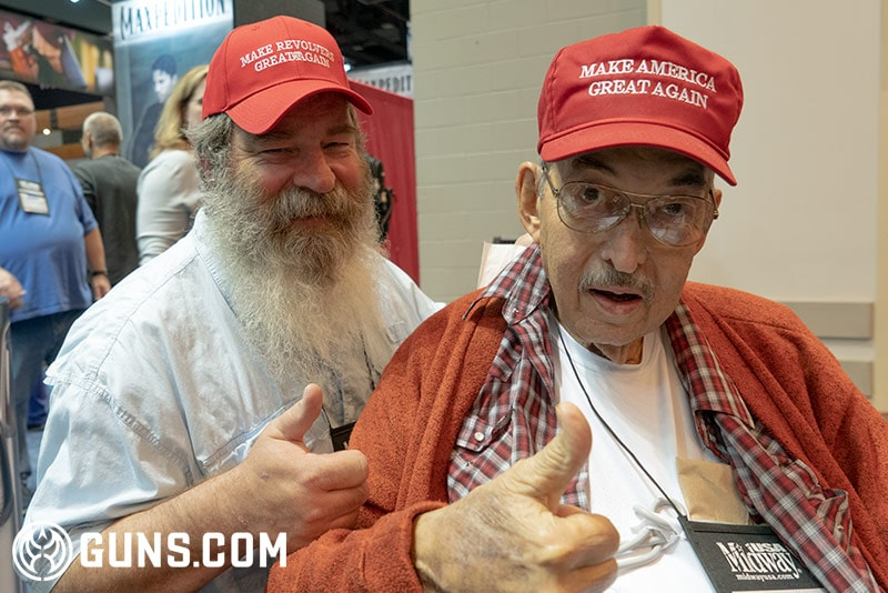 Father and son enjoying the NRA show and showing their support for Trump