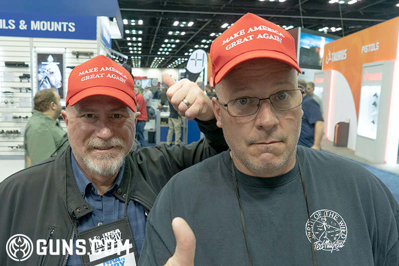 Two friends enjoying the NRA show and showing their support for Trump.