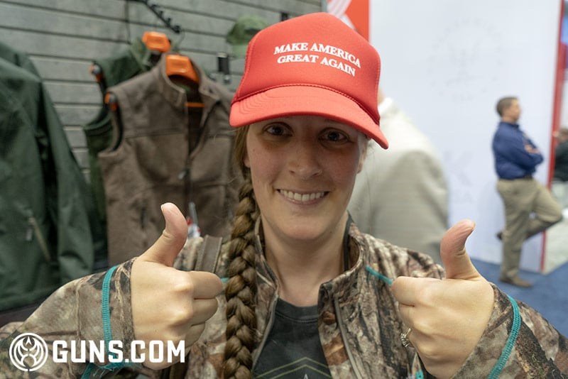 A young woman gives Trump two thumbs up