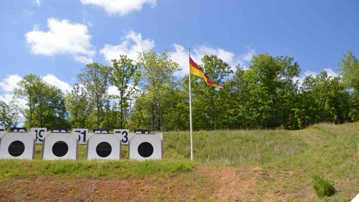 Shooting range berm showing range flag and Koingsberg targets