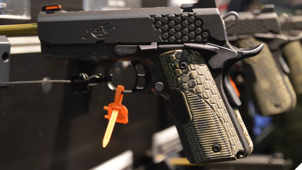 Row of Kimber pistols