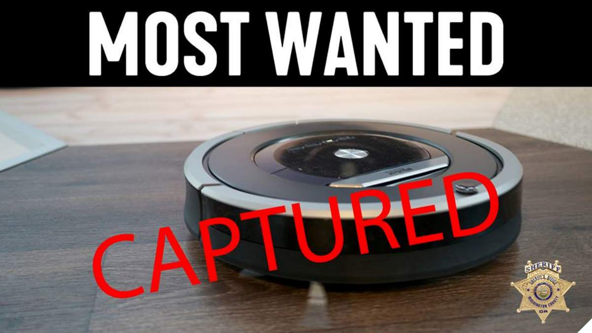 Roomba vac with MOST WANTED label and CAPTURED stamp by Washington County SO