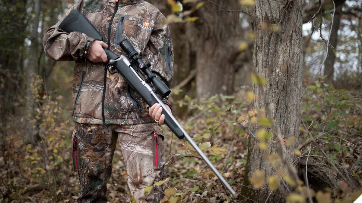 Savage 110 Apex Storm in the hands of a hunter in the woods
