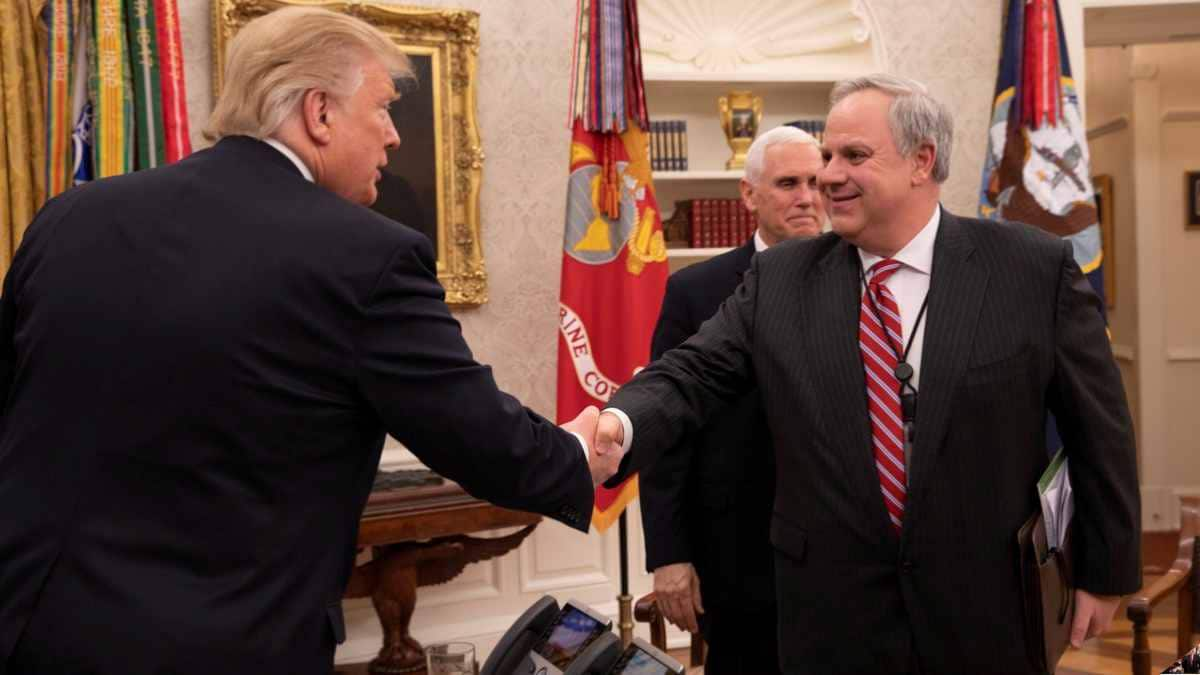 David Bernhardt shakes hands with President Trump in Oval Office