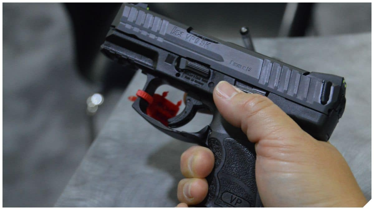HP VP9SK Heckler & Koch in a man's hands