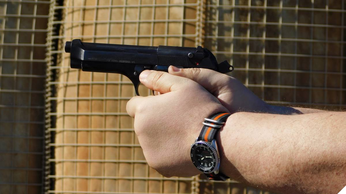 Beretta 92 series in the well muscled hands of a Teutonic god