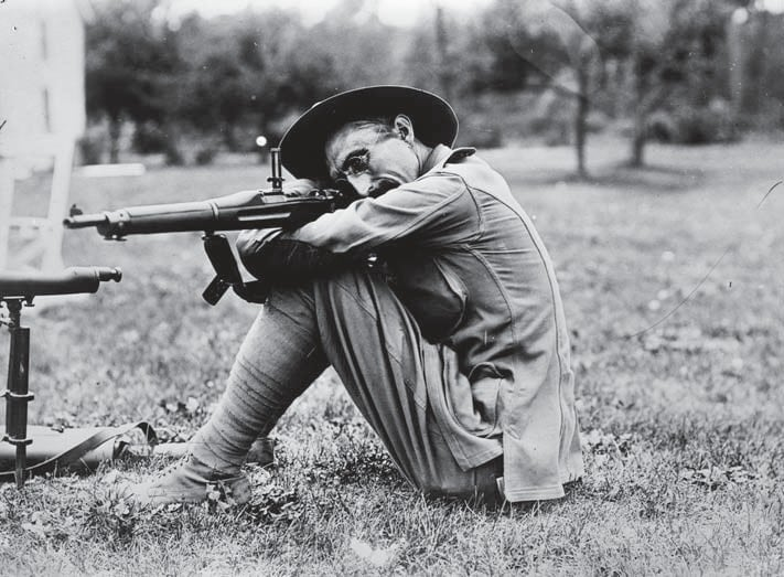National Guardsman Charles B.Winder, a well-known rifle shot, fires the M1903 from the seated position in 1911 1903 LOC