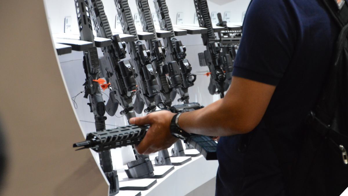 Man looks at Sig rifles