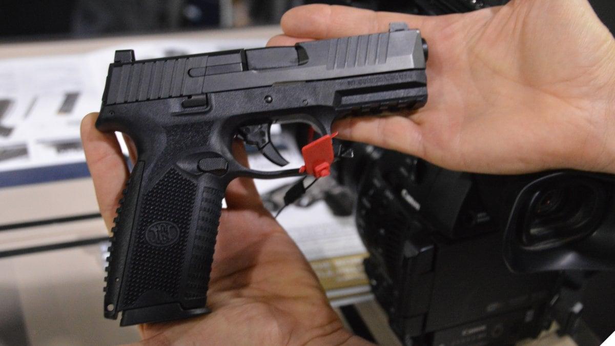 FN 509 pistol in a man's hands