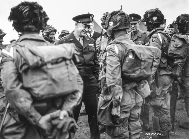Gen. Dwight D. Eisenhower, commander of Allied forces in Europe, meets with 101st Airborne Div paratroopers on the eve of D-Day. Note the M1911 holster on the man to the far left. The paratrooper to the far right has an M1 disassembled in a Gibbons bag while a Hawkins mine strapped to his lower leg. (Photo: National Archives Identifier 12003938)