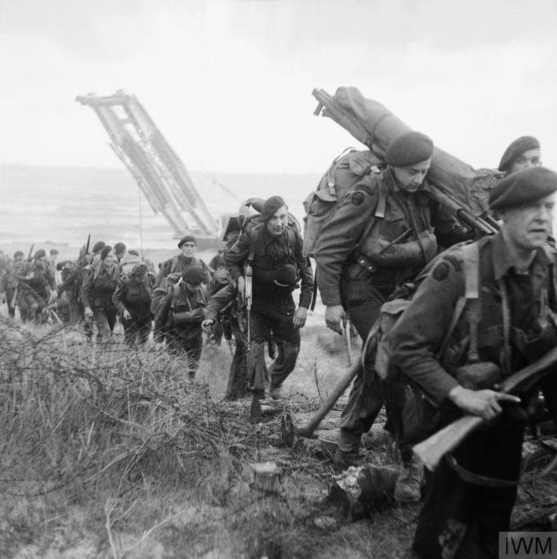 Royal Marine Commandos attached to 3rd Division move inland from Sword Beach on the Normandy coast, 6 June 1944 Thompson SMG Enfield 303
