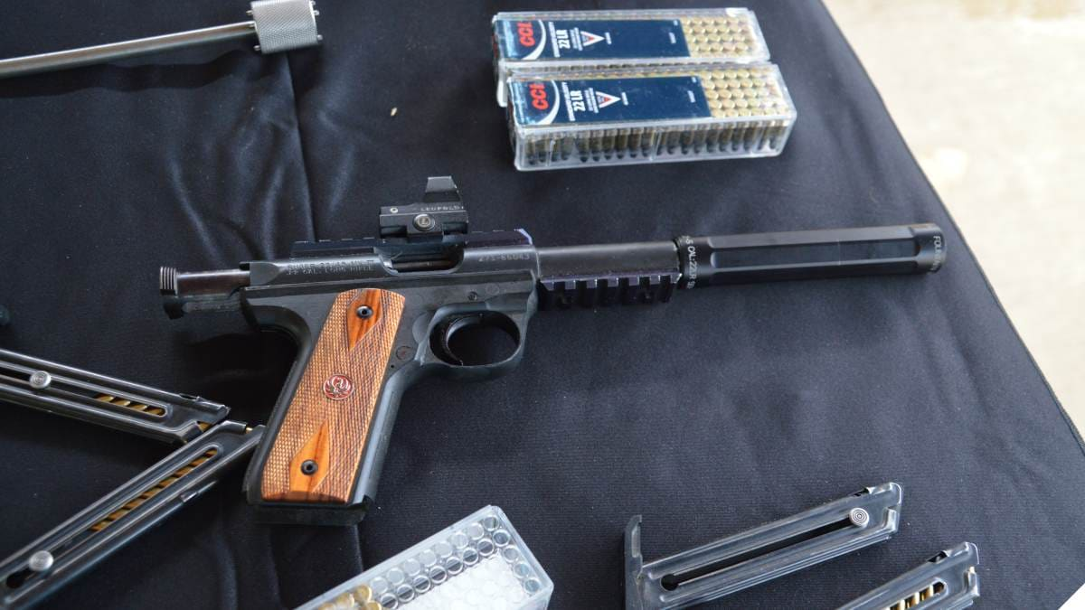 Ruger .22/45 MK III pistol with a SureFire SF Ryder 22-A suppressor and a Leupold optic with CCI ammo
