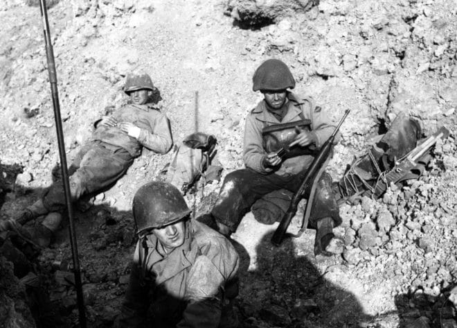 U.S. Army Rangers resting in the vicinity of Pointe du Hoc, which they assaulted in support of Omaha Beach landings on D-Day, 6 June 1944. M1 Carbine 80-G-45715