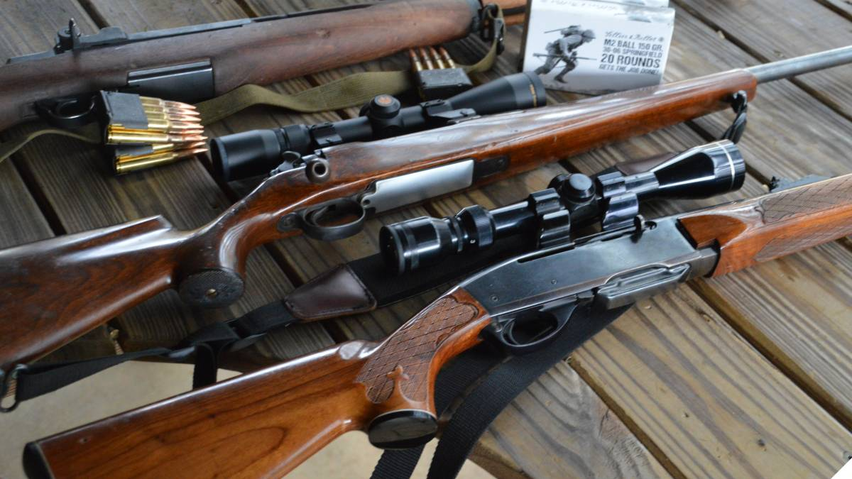 Remington 7400, M30 and M1 Garand rifles on a target bench